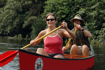 Honeymoon couple river canoeing